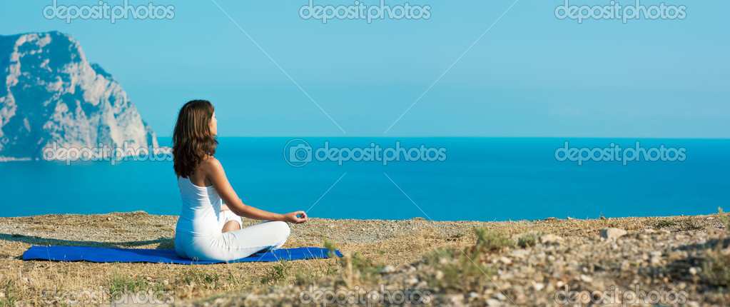 depositphotos_26165265-stock-photo-woman-doing-yoga-near-the.jpg